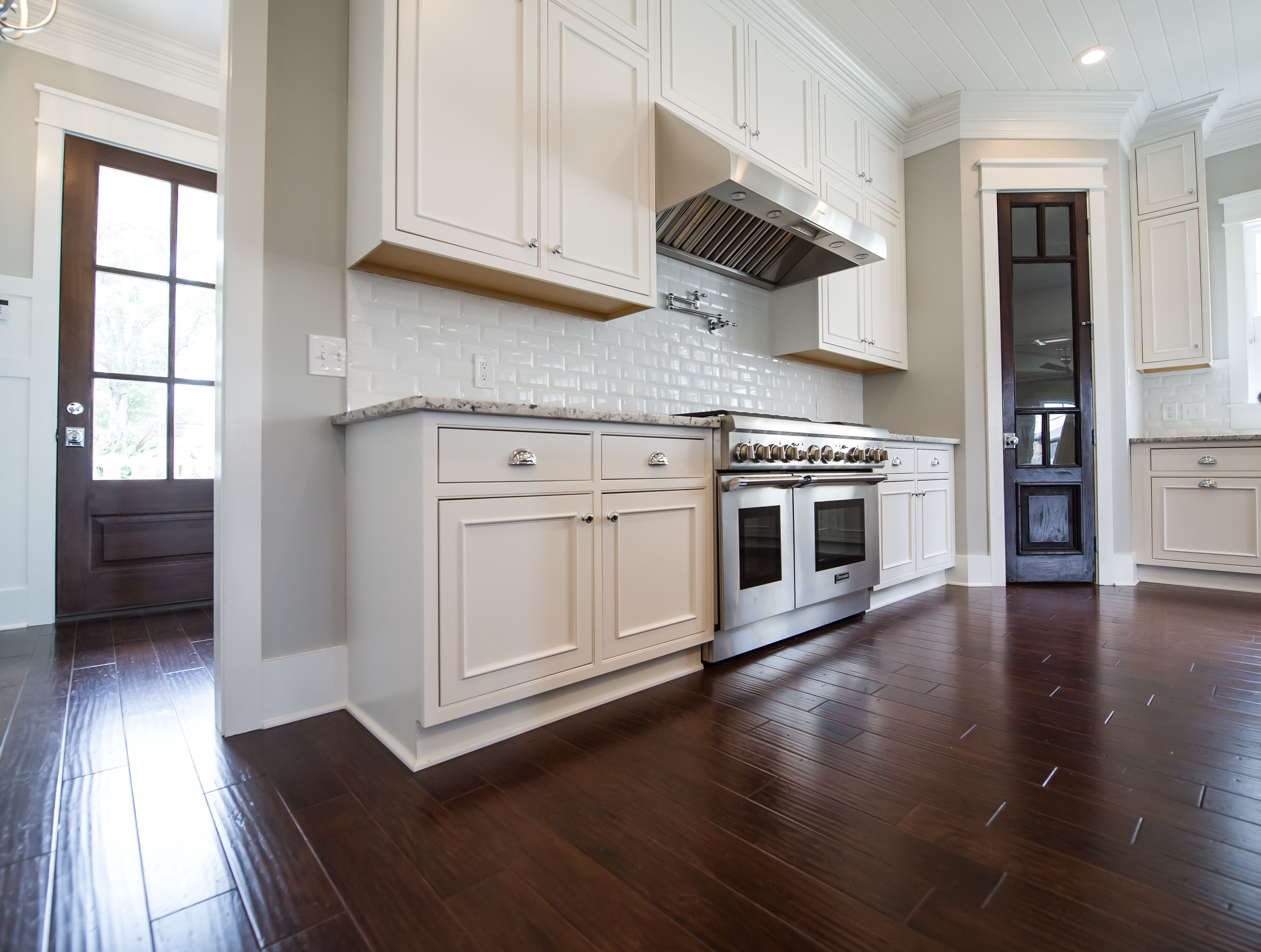 Kitchen with tongue and groove ceiling reclaimed cypress pantry kitchen with tongue and groove ceiling reclaimed cypress pantry door professional grade appliances subway tile dailygadgetfo Images
