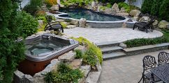 Want to see an awesome pool and spa in a small backyard?