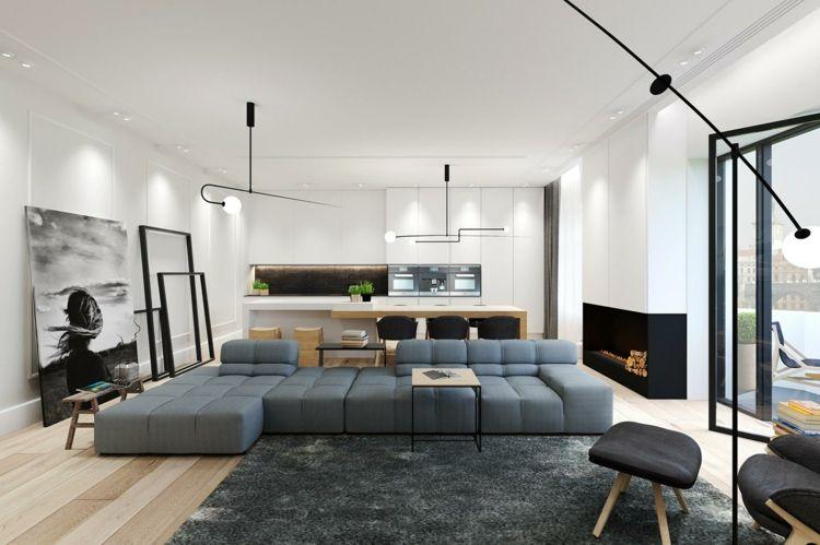 Offener Wohnbereich mit gradlinigen Möbeln und modernen Leuchten - moderne offene wohnzimmer