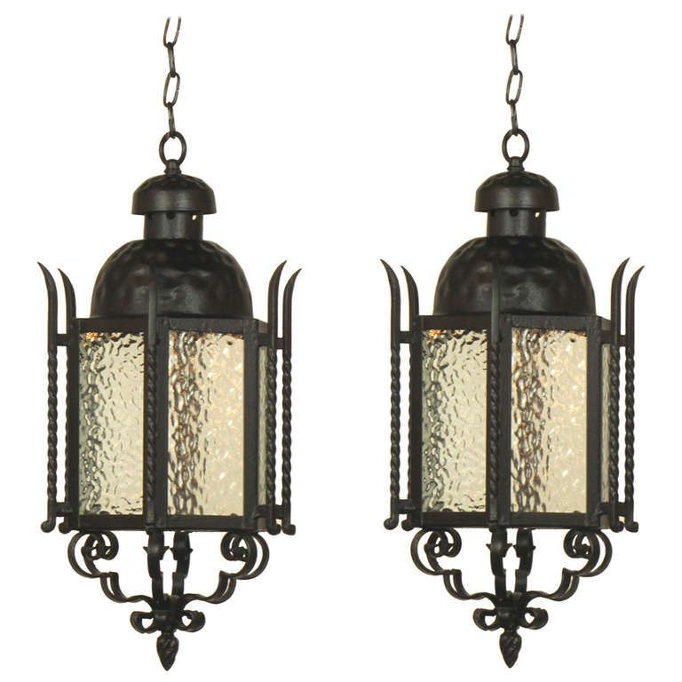 Pair of Wrought Iron Exterior Lanterns   From a unique collection of antique and modern lanterns at https://www.1stdibs.com/furniture/lighting/lanterns/