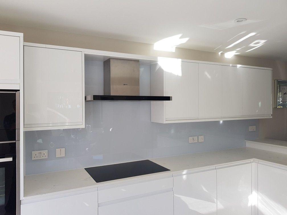 White gloss kitchen with Drifting Cloud Glass Splashback ...