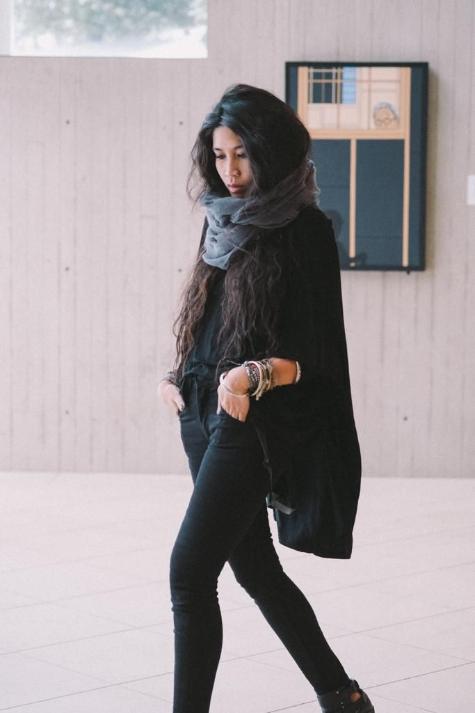 Kris from LoveYouDuh in BDG jeans and a UO scarf.