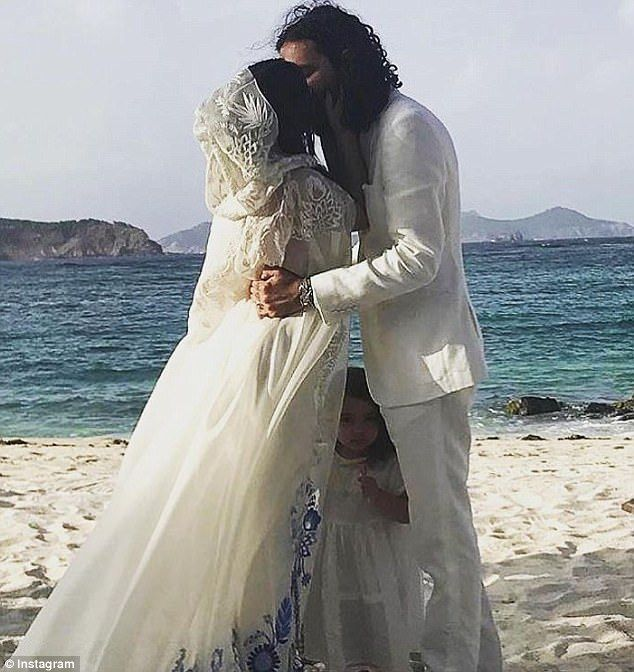 Saying I do: The bride wore a bohemian ensemble designed by her famous father of white sli...