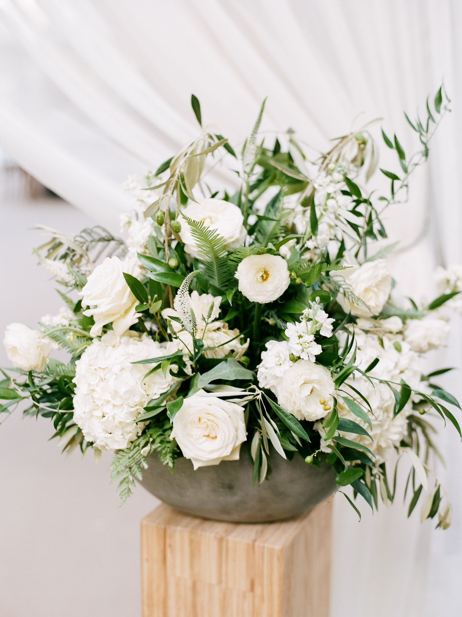 Gorgeous Florals At This Tent Entrance White And Greenery In A Slate Grey Vessel Clic White Floral Centerpieces Colorado Wedding Wedding Flower Inspiration