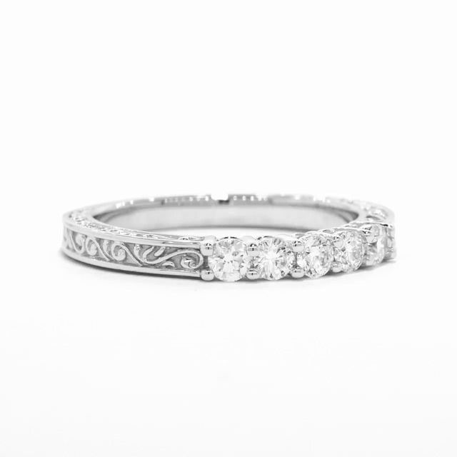 MY FAVORITE wedding band   This graceful antique-style ring features five sparkling diamonds set in beautifully sculpted shared prongs. An engraved scroll pattern adorns the top and sides of the band for a timeless look (0.30 total carat weight).
