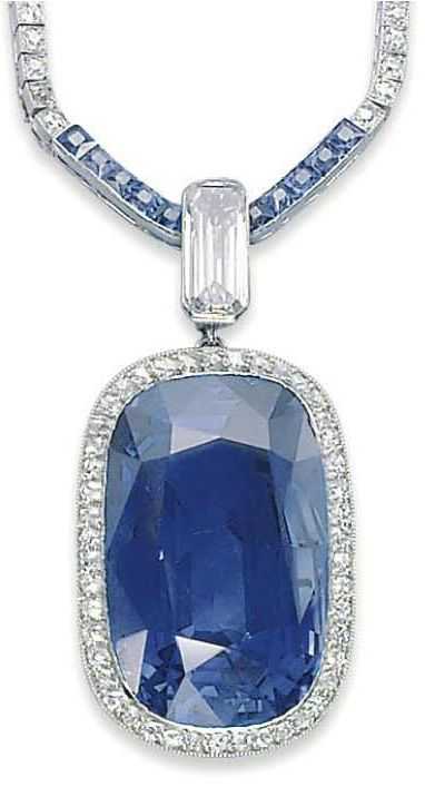 A BELLE EPOQUE SAPPHIRE AND DIAMOND NECKLACE, BY CARTIER, 1910S. The cushion-shaped sapphire set in a pavé-set diamond surround, with a rectangular-cut diamond surmount, to the calibré-cut sapphire and single-cut diamond line chain, four additional chain links, with French assay marks for gold, signed Cartier, with maker's mark for Atelier Henri Picq, numbered.