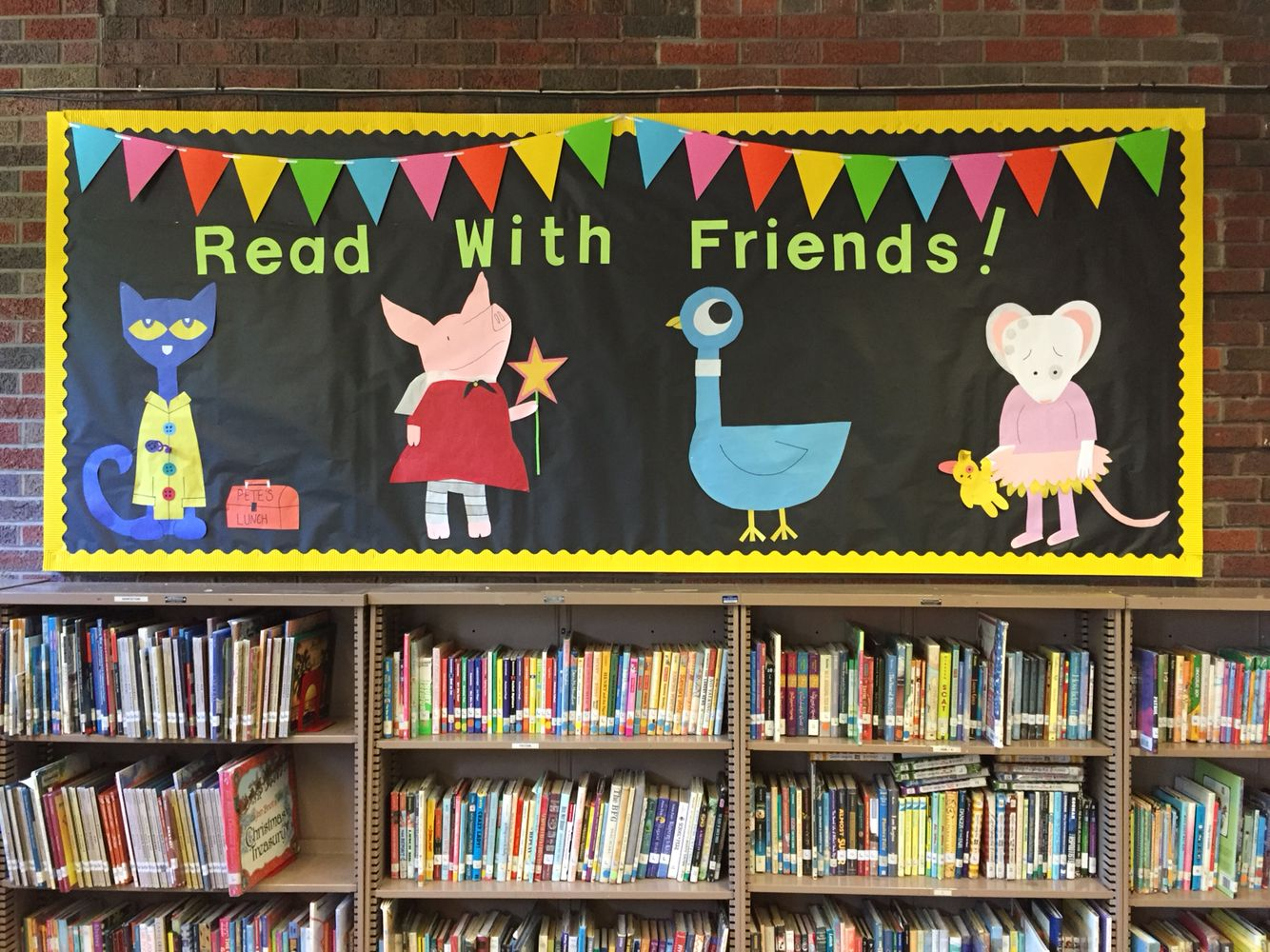 Library bulletin board pete the cat olivia pigeon for Cork board displays