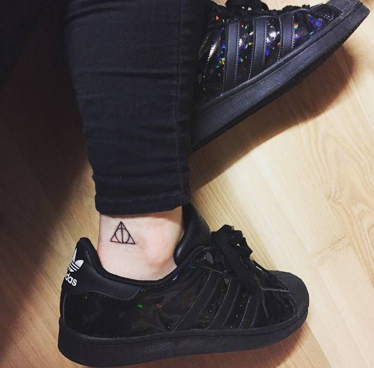 Deathly Hallows Sign Tattoo On Tessa S Ankle Ankle Tattoo Designs Harry Tattoos Ankle Tattoo