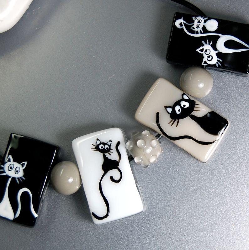 https://flic.kr/p/Gy6csF | DSC_0085 | fused glass bead enamels cats white black gray