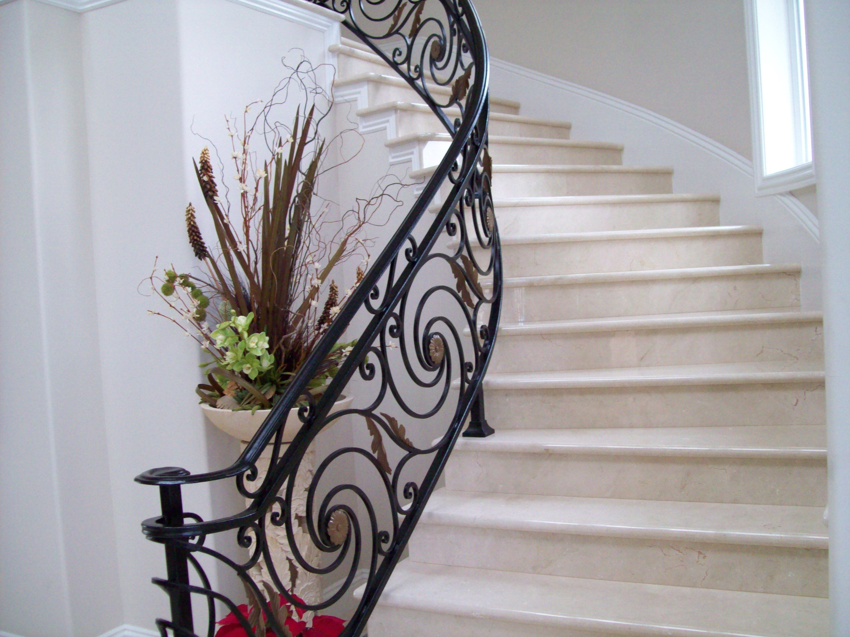 Curved Staircase With Rod Iron Spiral Rails Iron Stair Railing