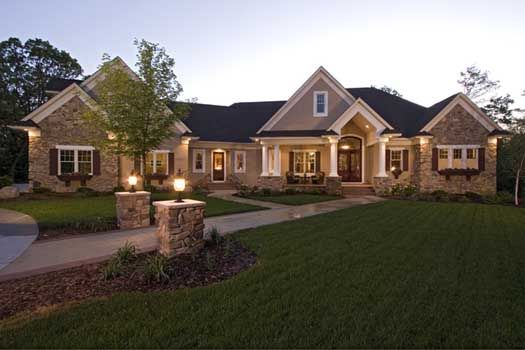 Want outside lighting similar to this home. Also like the stone ...