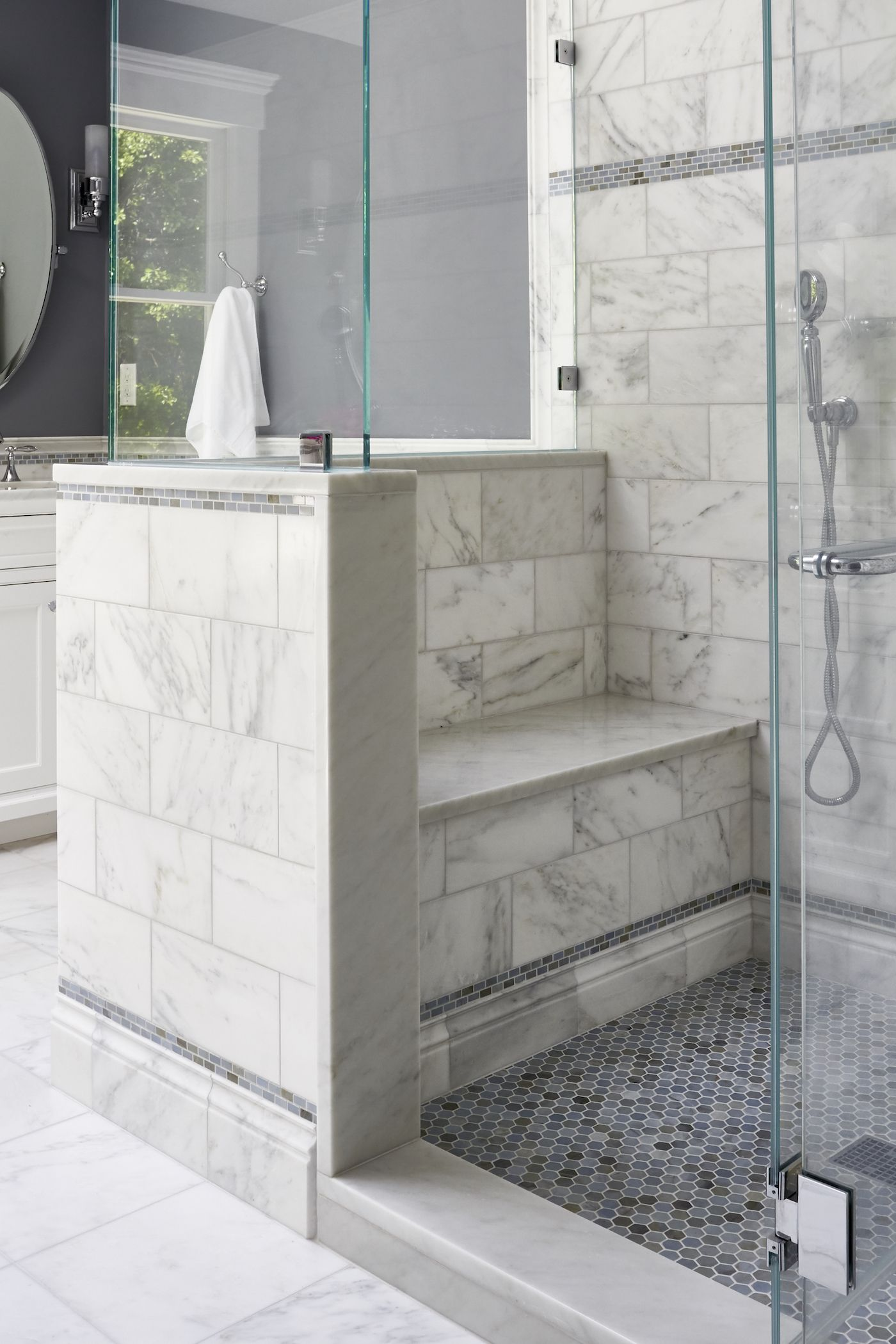 Built In Shower Bench In Master Bathroom Using White Carrara Marble