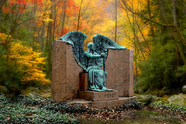 The stoic angel is seated in the marble gravestone of one Francis Haserot. Sculpted in 1924 by Herman Matzen.