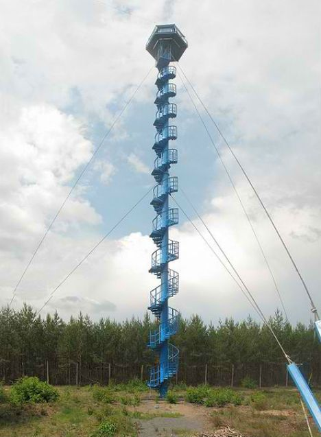 Poland Fire Tower House Very Little Information Is Available But This Spiraling Blue Fire Tower In Poland Is Purpo Lookout Tower Houses In Poland Tower House