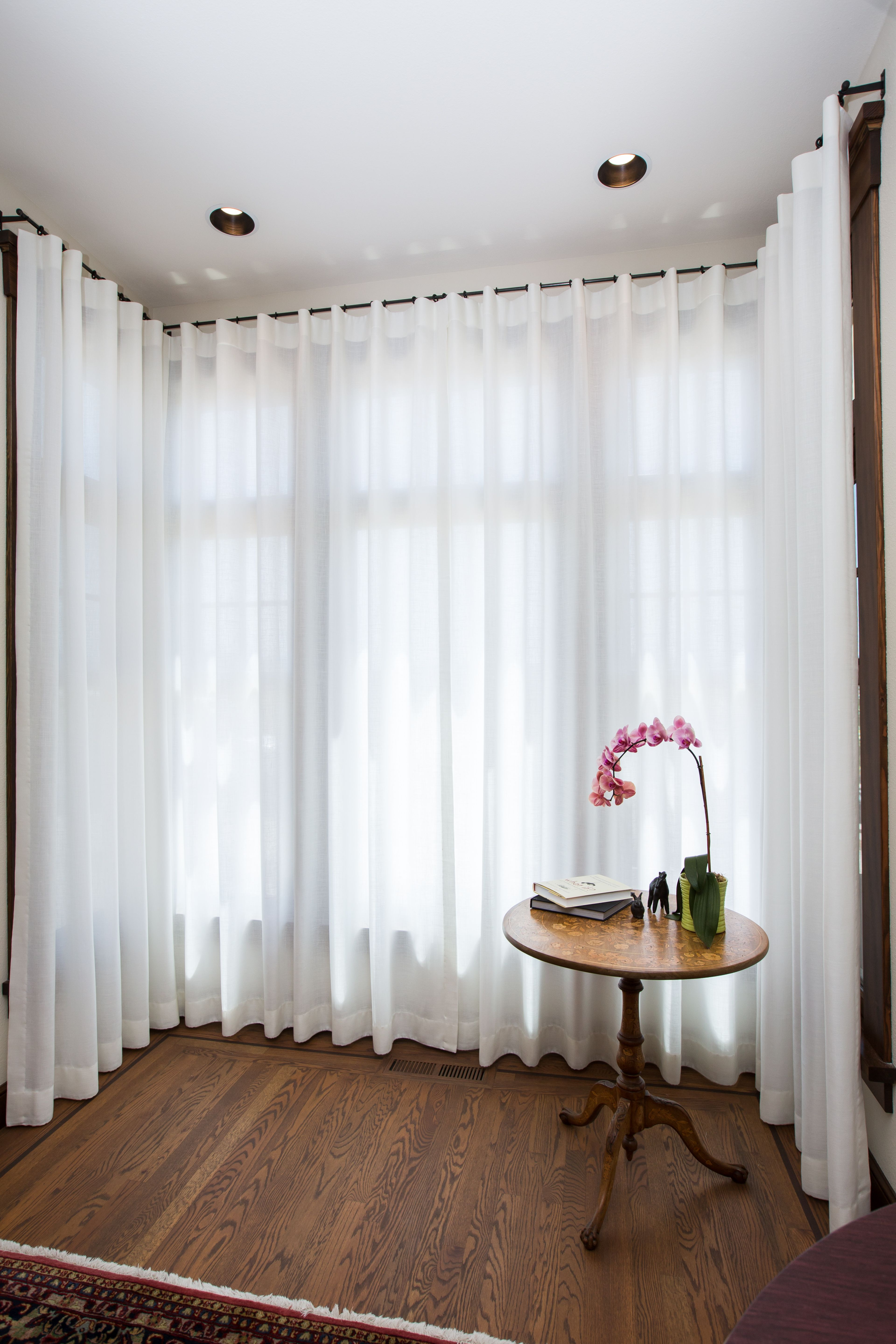 Sheer ripple curtains in a square bay umami window - Curtains for bay windows in living room ...