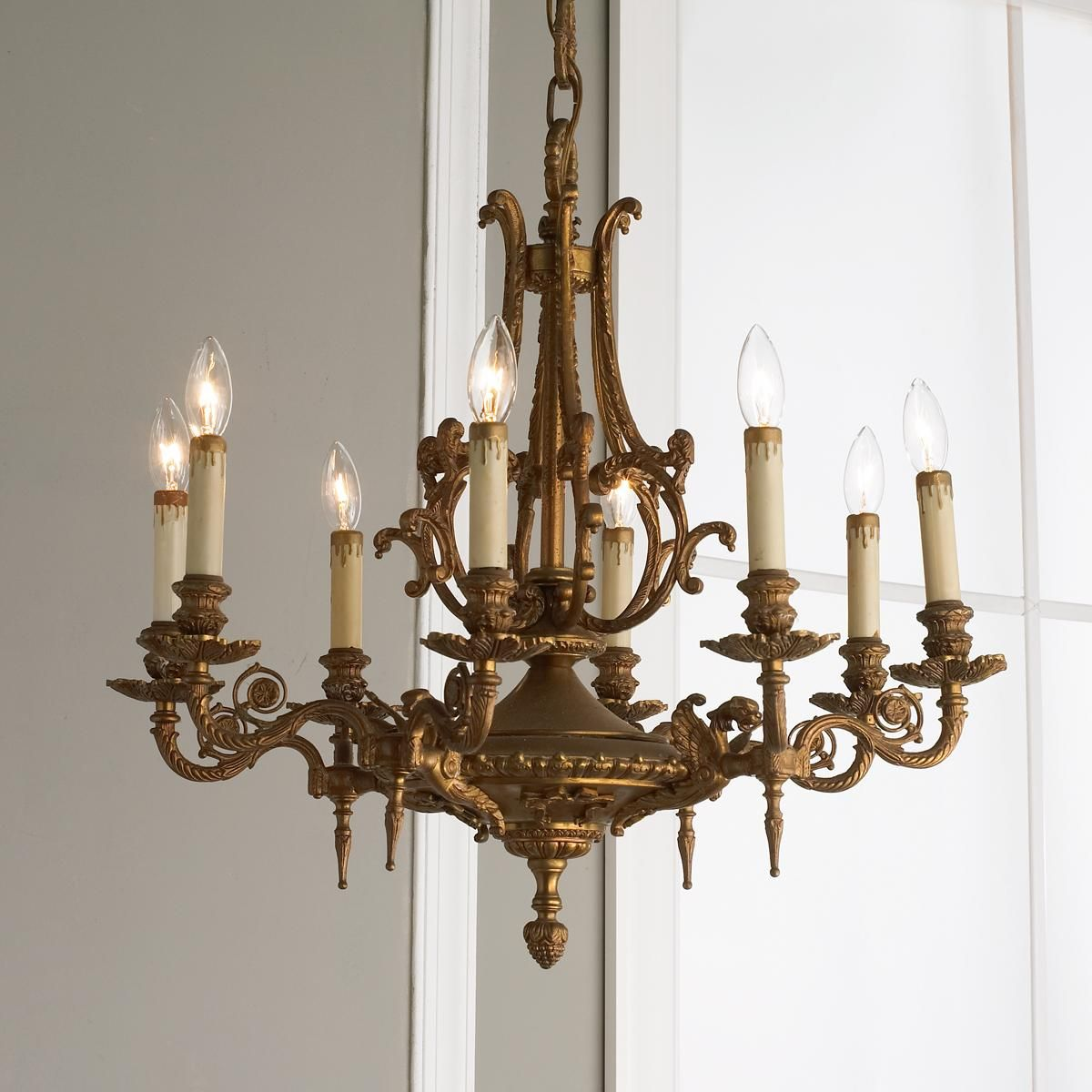 Antique griffin 8 light brass chandelier i love antique lighting antique griffin brass chandelier gathering room or master bedroom aloadofball Image collections