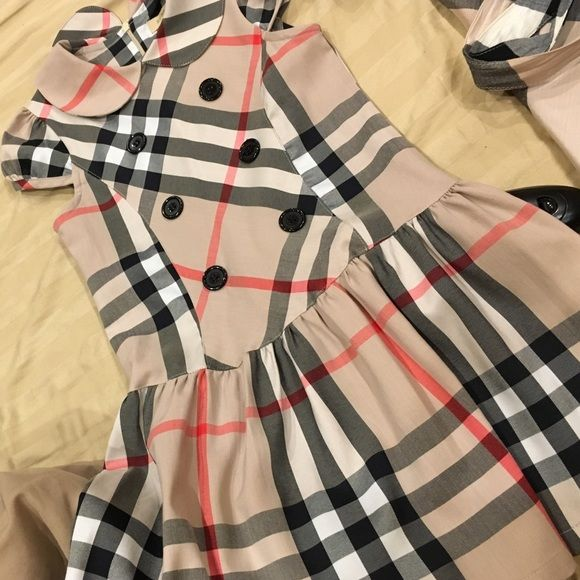 Burberry Girls Dresses Selling the 2nd one only left Burberry girl dress purchased here on posh so no proof of authenticity  I've compared to my tops and i would say they are Burberry Dresses Maxi