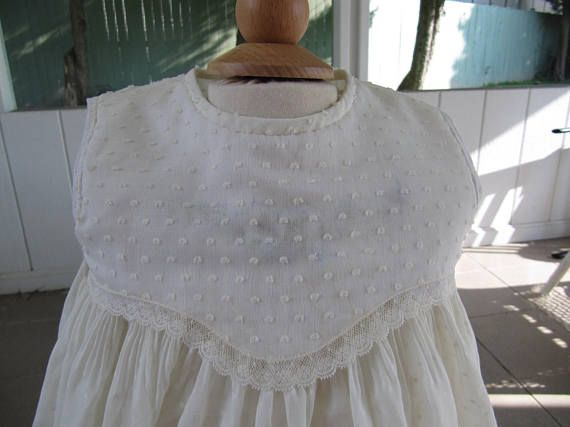 b598c21eb18 Dotted Swiss voile in champagne color is smocked from shoulder to waist and  decorated with gorgeous