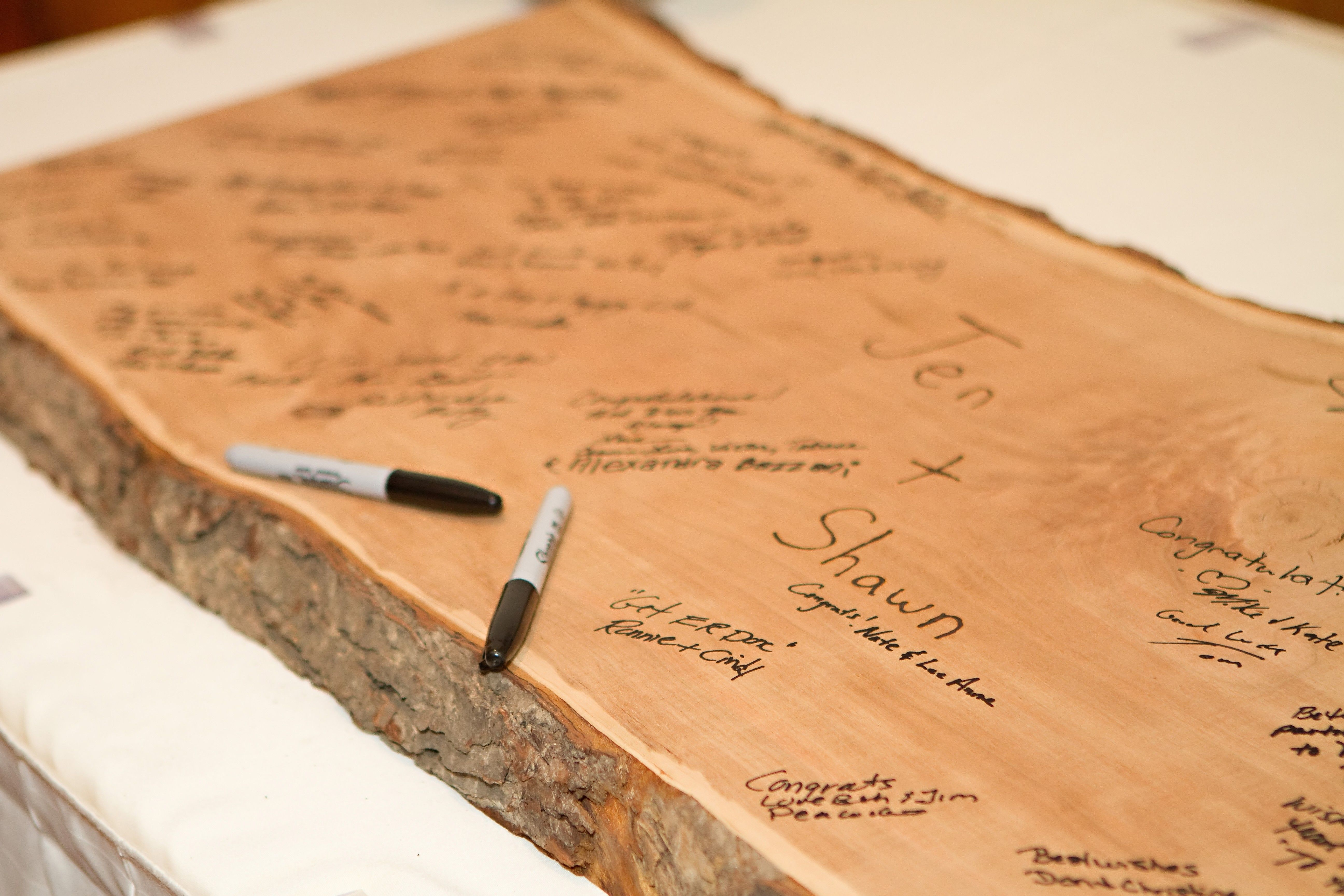 Guest book slab of wood camping themed wedding for Wood slab ideas