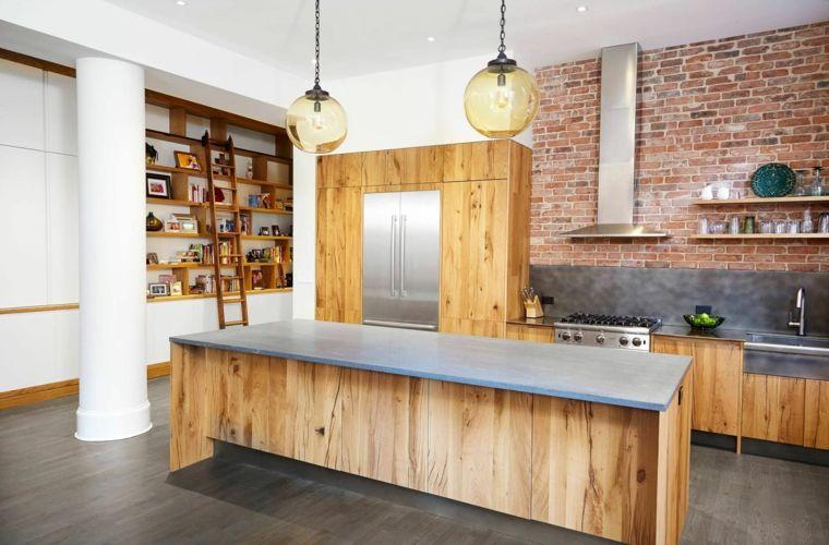originale arredamento per una cucina open space con isola in legno cappa in acciaio e