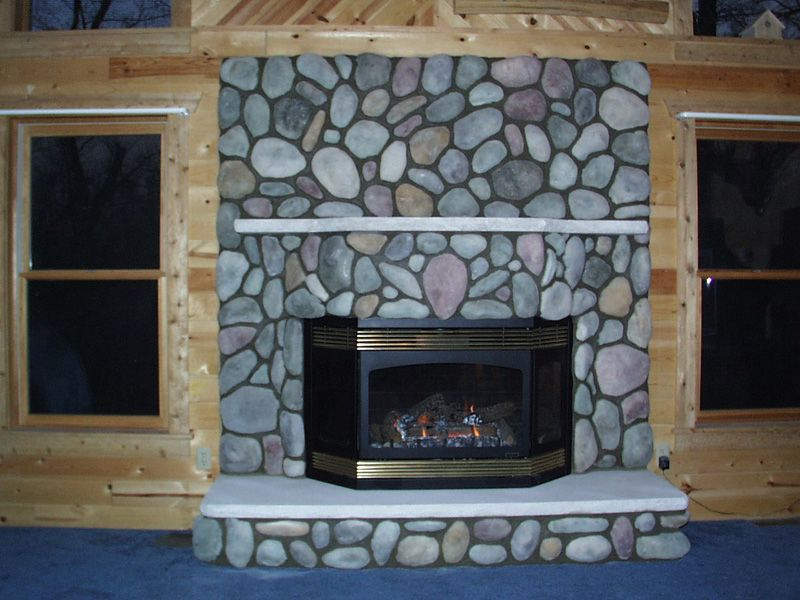 Rock Fire Place river round stone fireplace | portfolio | fenner builders