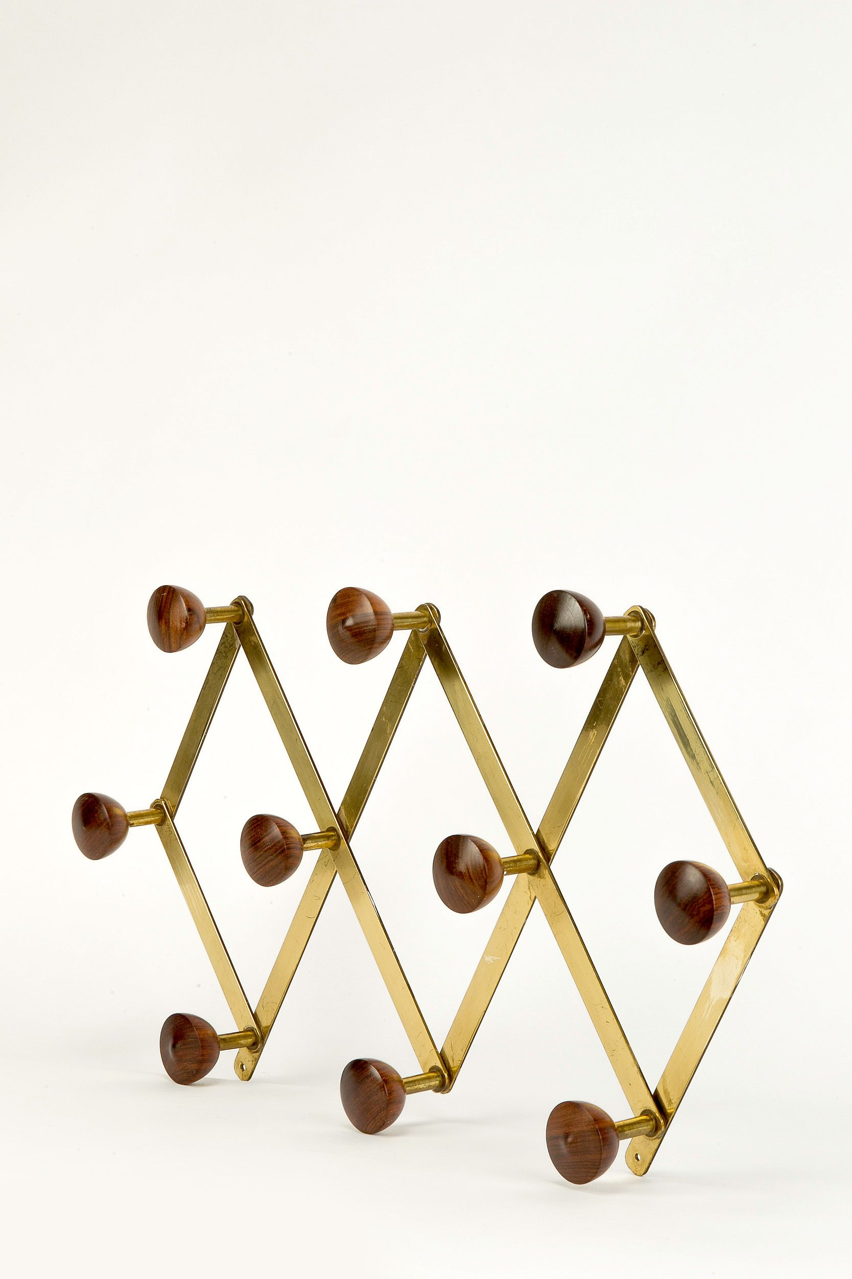 Luigi Caccia Dominioni; Brass and Rosewood Coat Rack for Azucena, 1950s.