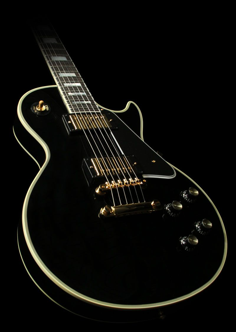 "This is the 50th anniversary reissue of the Gibson 1960 Les Paul Custom, nicknamed ""the Black Beauty"". It has a Mahogany top instead of a maple one. The ""Custom"" was introduced in 1954 with P90s, it got PAFs humbuckers in '57."
