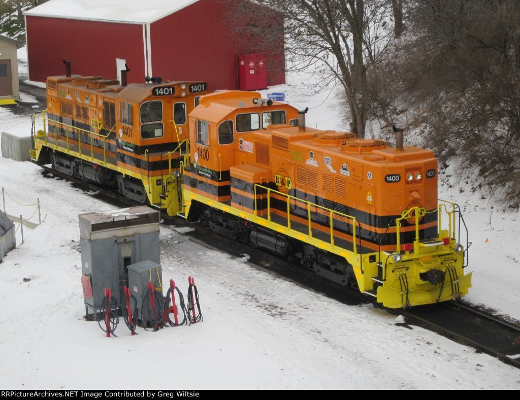 Both of BPRR's new GS1400 genset units, 1401 and 1400   Description:  You can tell here that 1401 has been in service and has been used longer than newer 1400.   Photo Date:  12/28/2010  Location:  Butler, PA   Author:  Greg Wiltsie  Categories:    Locomotives:  BPRR 1401(GS1400) BPRR 1400(GS1400)