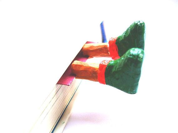 Green boots bookmark Christmas uggs in the book. Ugg shoes. Christmas gifts