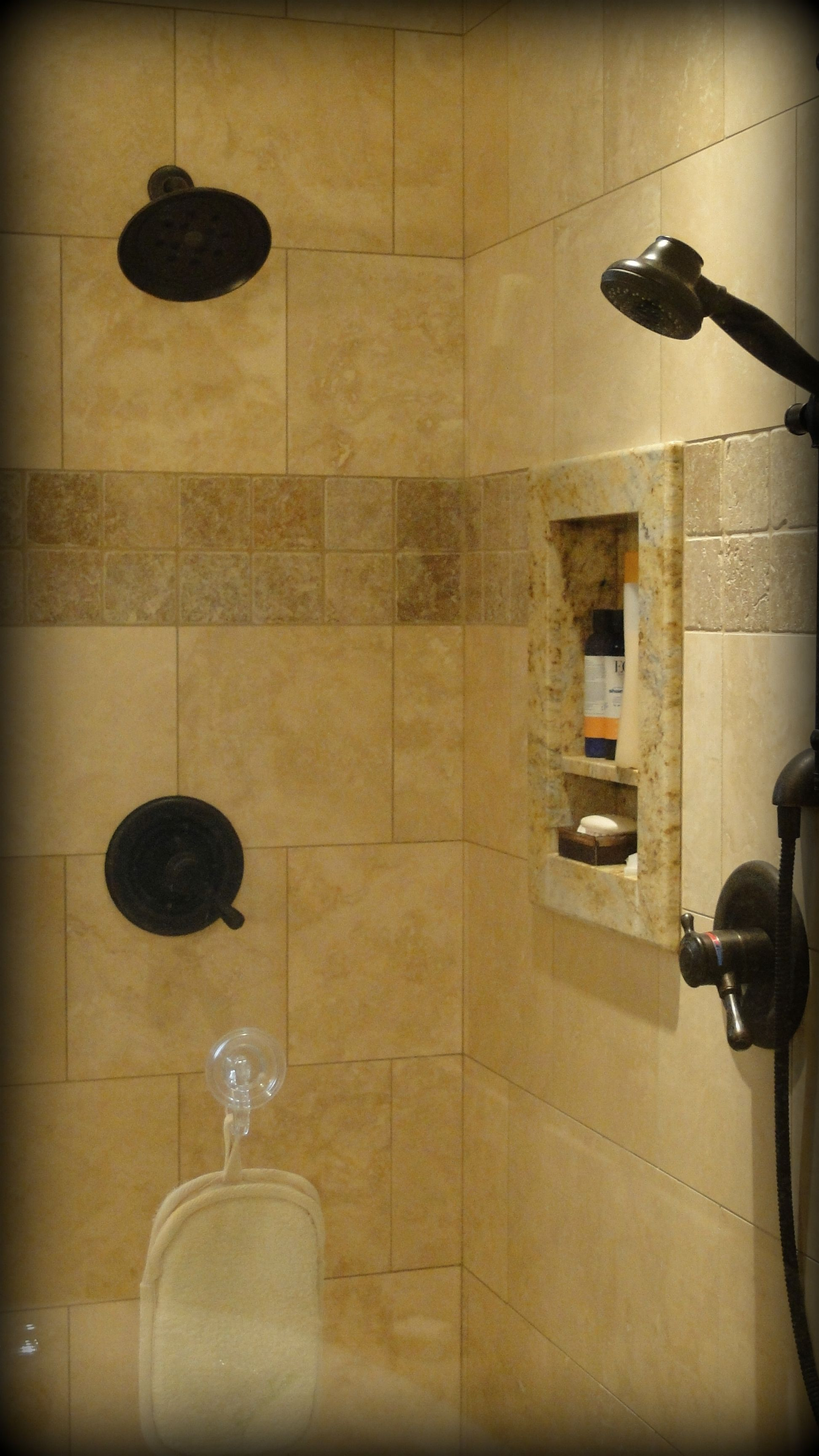 Large, tiled master shower with oil rubbed bronze Delta fixtures and ...