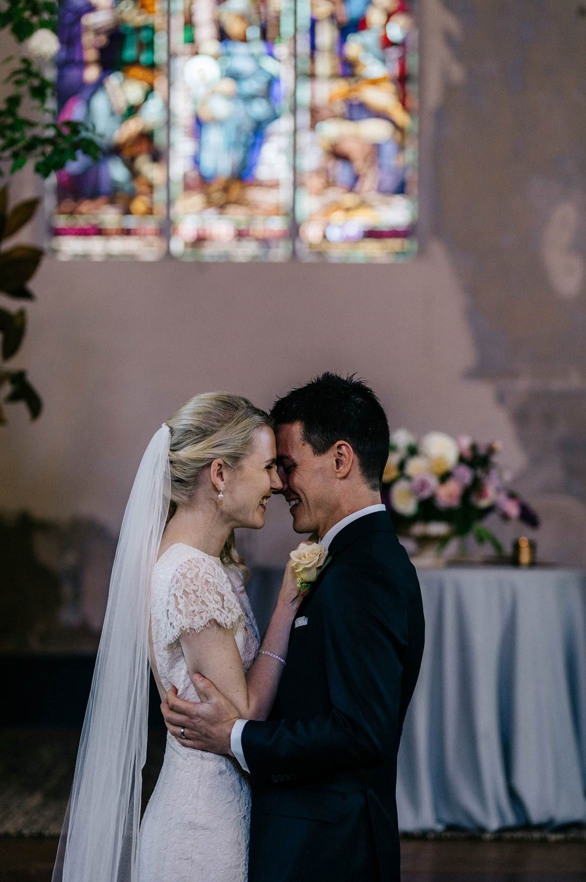Country wedding a historic church filled with lush flora