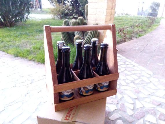Bottle holders for Beers 0.33 cl entirely handmade. Ideal for birthday gifts for Father's Day, in short, for anyone who loves beer. Every bottle holder is proudly made by hand and this is a unique piece.  https://www.etsy.com/it/listing/261322199/porta-bottiglie-in-legno-artigianale-per