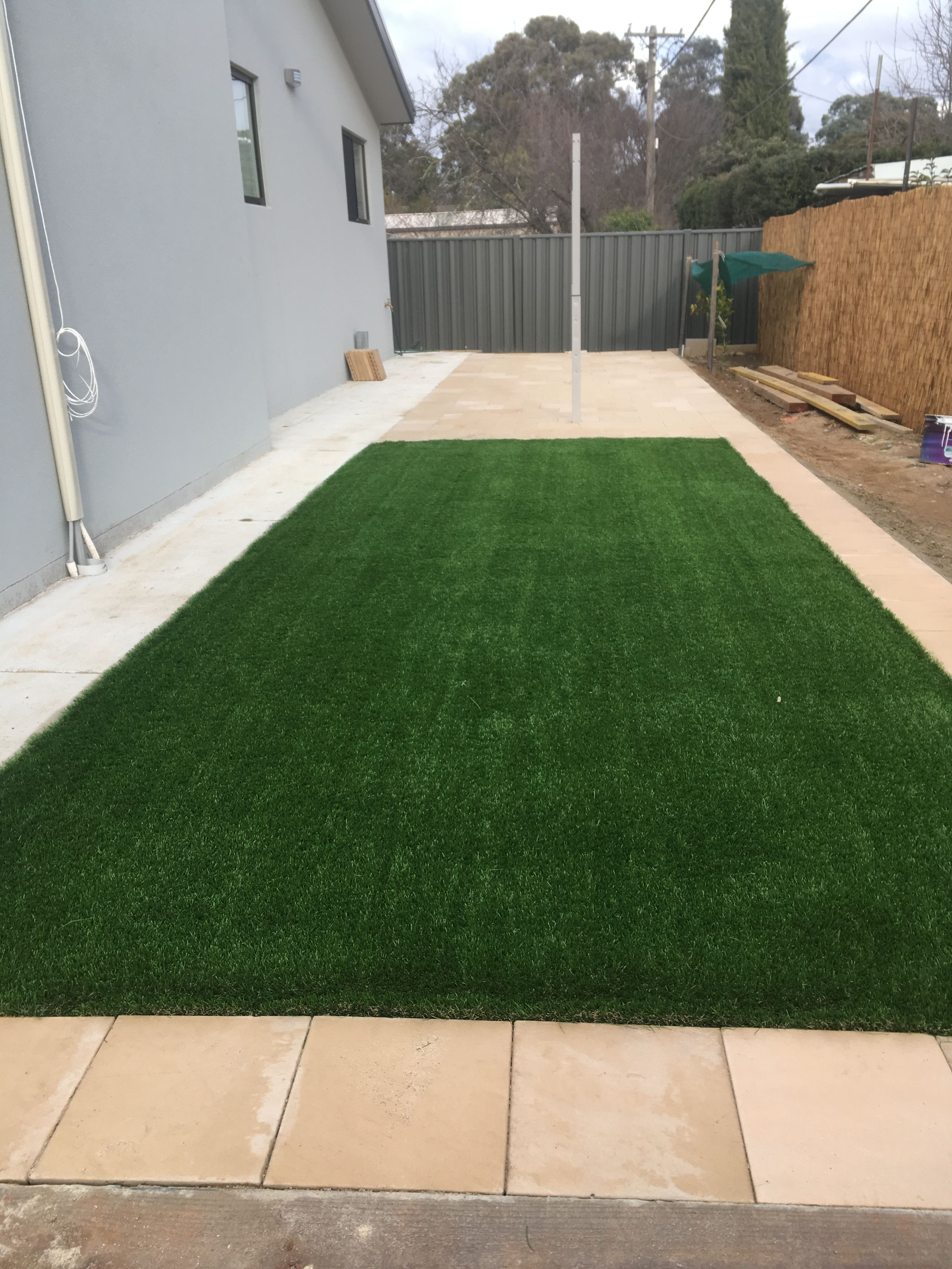 clothesline area paving and turf synthetic grass and paving