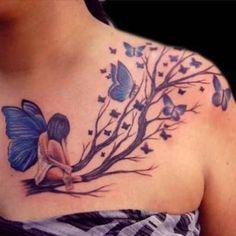 Photo Tattoo Feminin Branches Arbre Avec Fee Et Papillons Bleus Haut