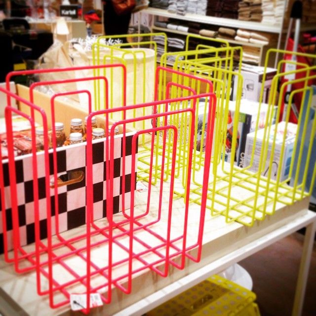 Wire magazine baskets in neon pink and yellow.  Zingy colours for Spring 2015 decor trend