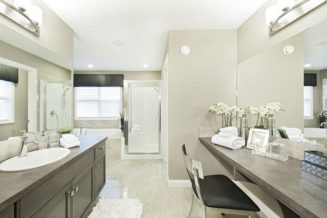 Ensuite Bathroom Edmonton mirrors lend a sense of openness to this en-suite in jayman