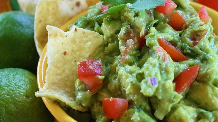 This refreshing guacamole has lots of lime juice, cilantro, and green onions for a dip everyone will love. Serve with tortilla chips or as topping for Mexican dishes.
