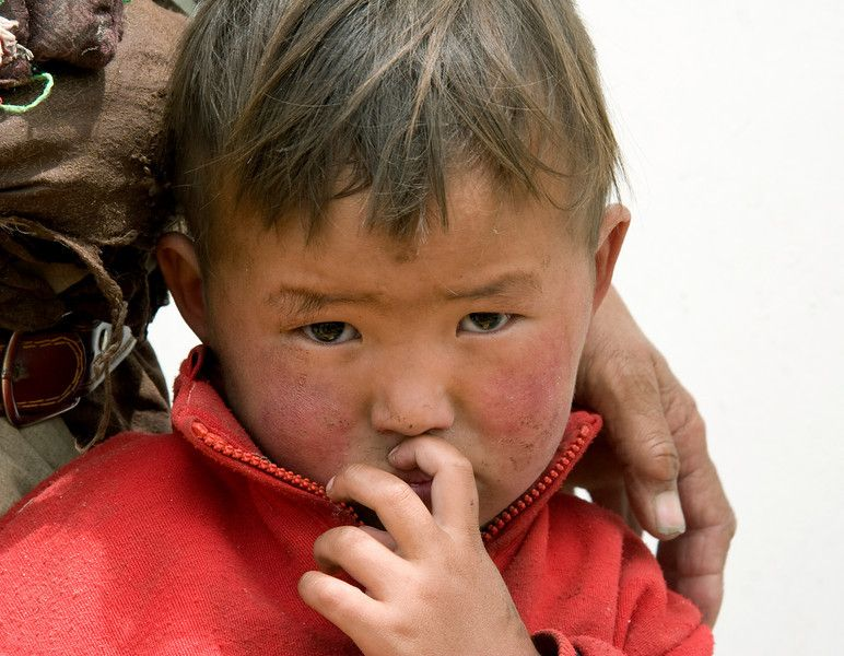 A Tibetan boy with a bleak future. . . The Chinese