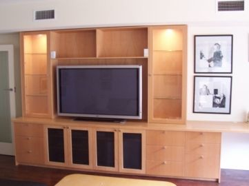 european beech tv unit with glass display cabinets features include cabinet lights infra red