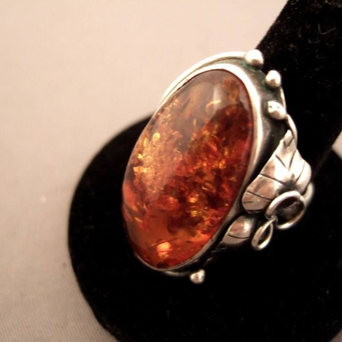 """A splendid ring in silver sterling and floral motives ornated with an astonihing piece of amber coming from the baltic area ...ideal for both male and female ... For sale in my shop at 28, Galerie du Roi at 1000 Brussels and very soon online www.halter-ethnic.com under the item """" My Lucky Finds"""" ..."""