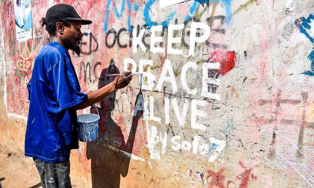 celebrations in kibera slums as Raila wins presidential petition - business petition