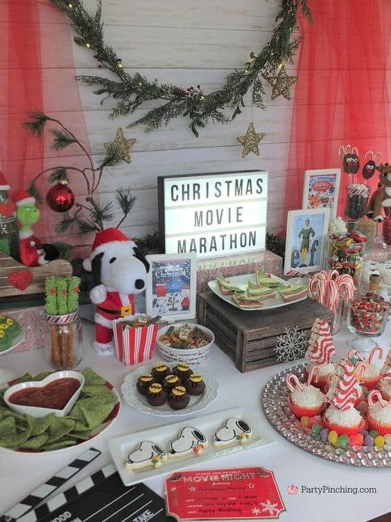 Pop some popcorn, light the fire, and get ready to settle in with your guests for a movie marathon featuring all of the Christmas classics. #christmaspartyideas #christmasparty #christmasparties #christmaspartythemes #partythemes #christmasmovies