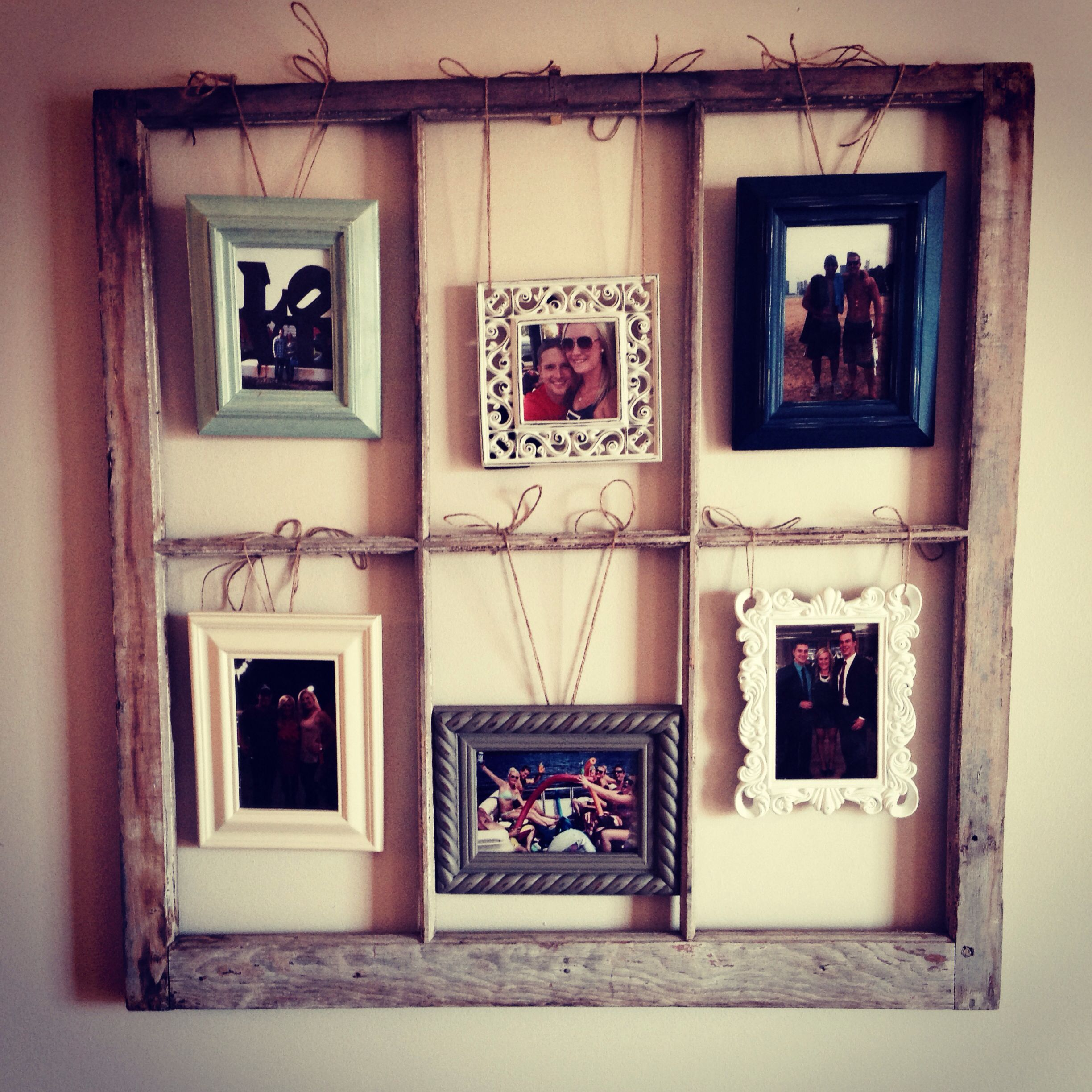 made out old window frame mix match picture frames hung with twine diy pinterest window. Black Bedroom Furniture Sets. Home Design Ideas