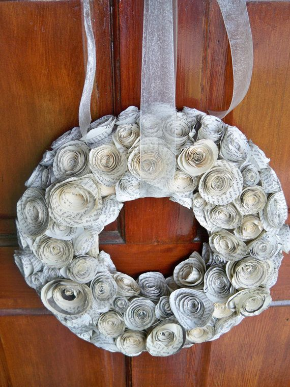 Paper rose wreath made out of newspaper or written letters.