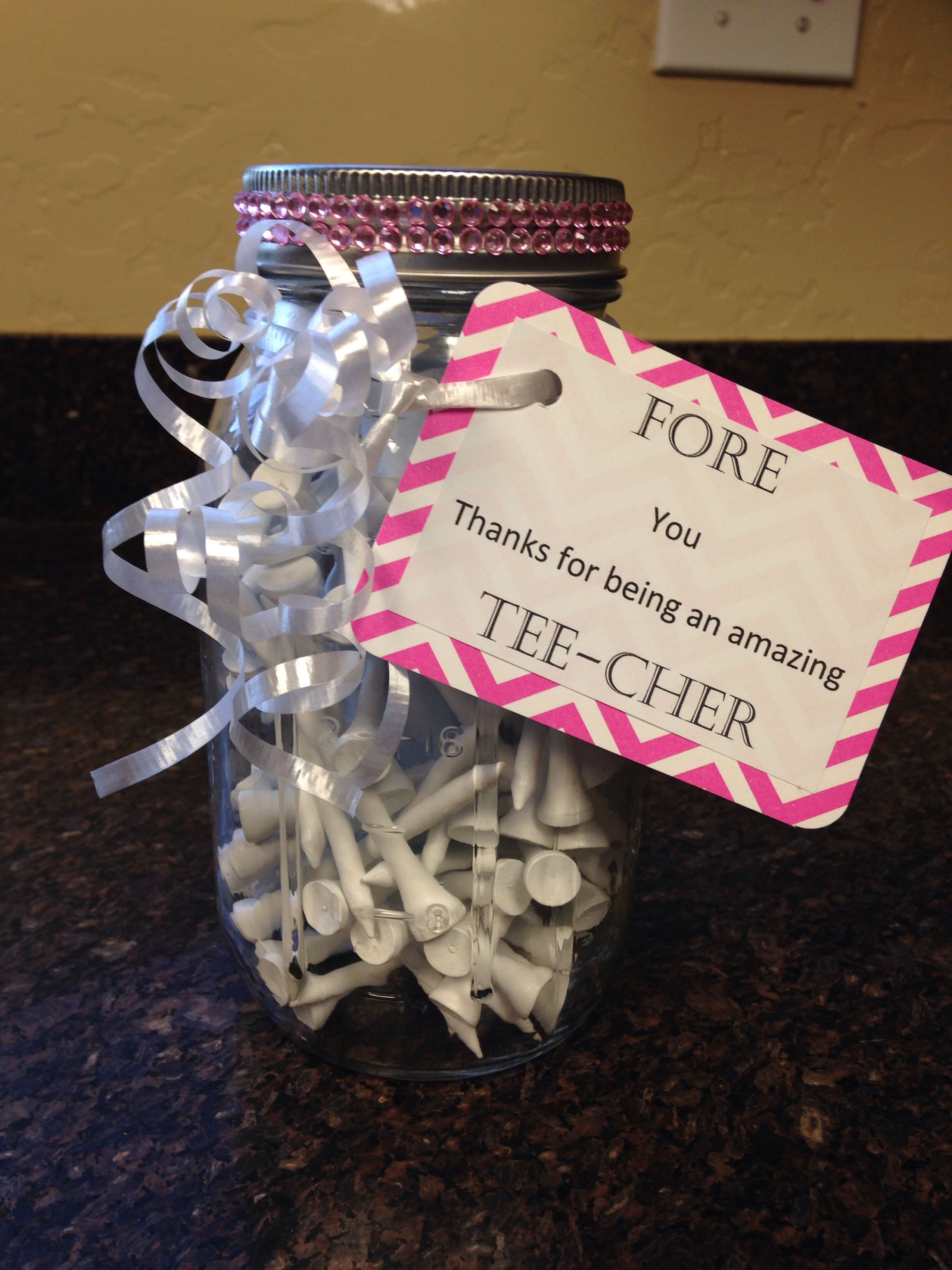 For my daughter's teacher.  A gift certificate to the local golf course inside the mason jar.