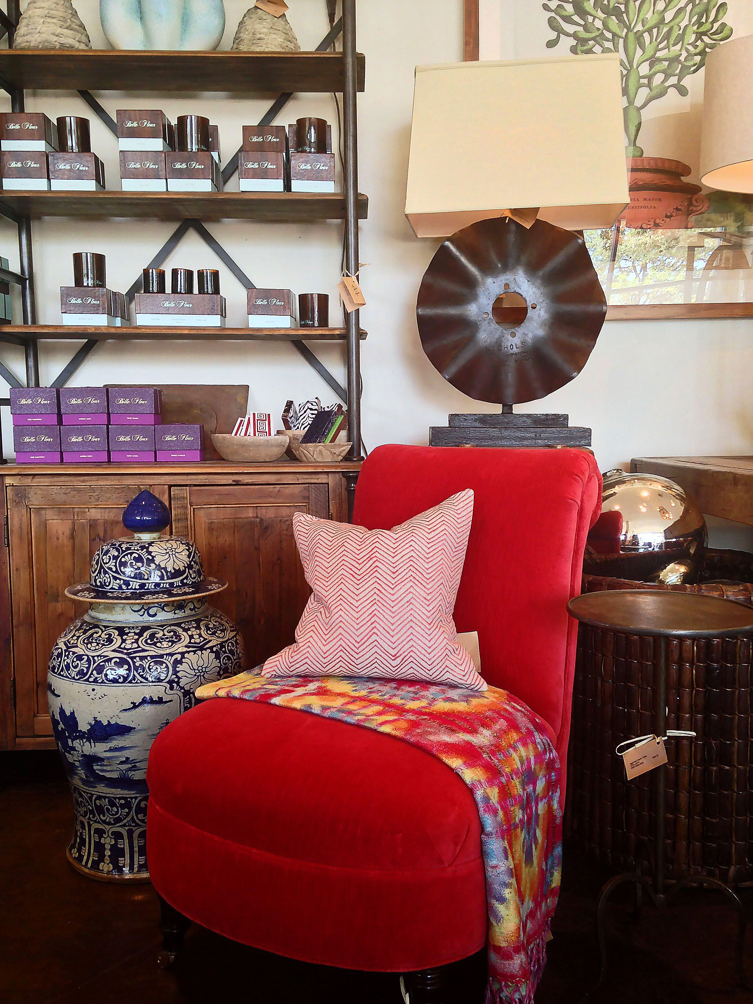 Red upholstered #chair with tie dye throw #blanket makes the ideal accent piece at #Dallas #Mecox #interiordesign #mecoxgardens #furniture #shopping #home #decor #design #room #designidea #vintage #antiques #garden