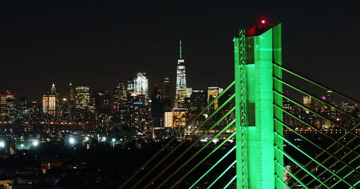 NYC sites illuminated green to support Paris climate deal #Politics #iNewsPhoto