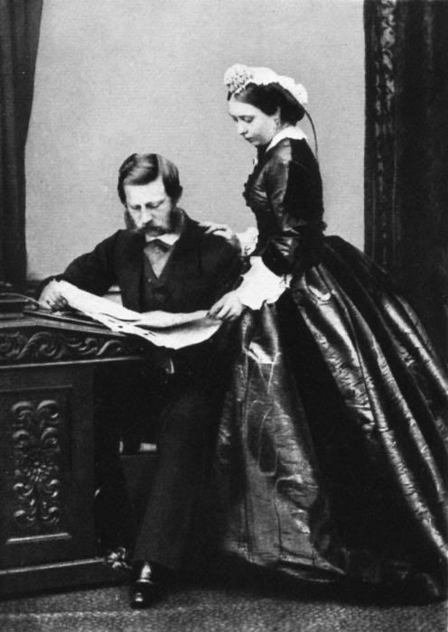 This is Queen Victoria with her eldest daughter, Victoria, born in 1840; the younger Victoria was destined to marry a German prince, become a Queen and Empress, and be widowed relatively early in the saddest of circumstances. The photographic record of her life thus bears an uncanny resemblance…