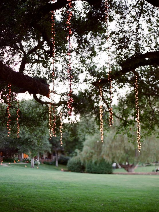 love these hanging string lights from trees!! i hate when ...