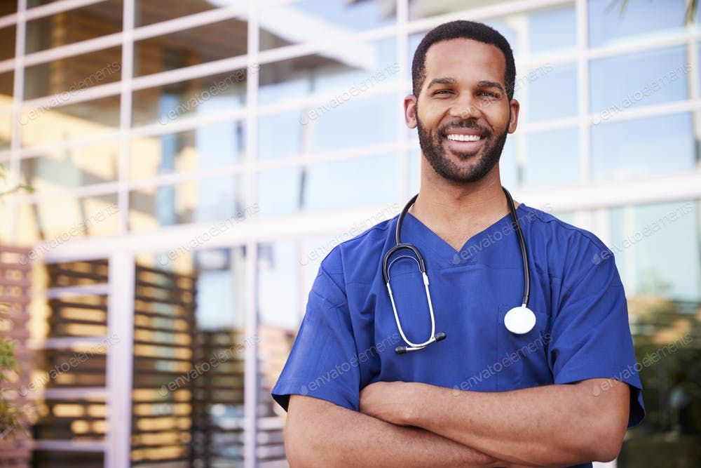 Young black male healthcare worker smiling outside